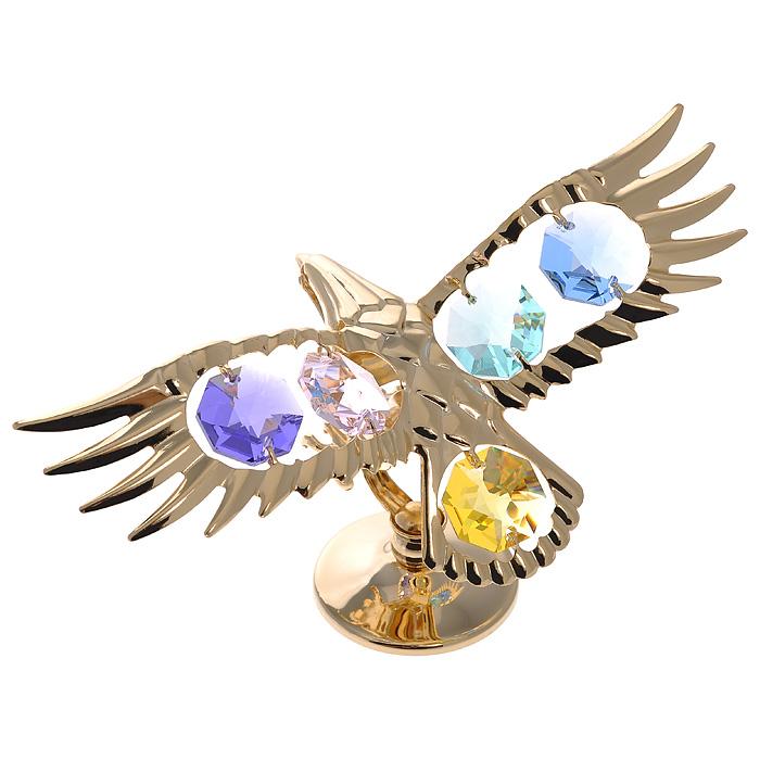 Фигурка декоративная Орел, цвет: золотистый67134Декоративная фигурка Орел, золотистого цвета, станет необычным аксессуаром для вашего интерьера и создаст незабываемую атмосферу. Фигурка выполнена в виде парящего орла на подставке и инкрустирована разноцветными кристаллами. Кристаллы, украшающие фигурку, носят громкое имя Swarovski. Ограненные, как бриллианты, кристаллы блистают сотнями тысяч различных оттенков. Эта очаровательная фигурка послужит отличным функциональным подарком, а также подарит приятные мгновения и окунет вас в лучшие воспоминания. Фигурка упакована в подарочную коробку. Характеристики: Материал: металл (углеродистая сталь, покрытие золотом 0,05 микрон), австрийские кристаллы. Размер фигурки: 11 см х 6 см х 5 см. Цвет: золотистый. Размер упаковки: 7,5 см х 10 см х 5 см. Артикул: 67134. Более чем 30 лет назад компания Crystocraft выросла из ведущего производителя в перспективную торговую марку, которая задает тенденцию благодаря безупречному чувству...