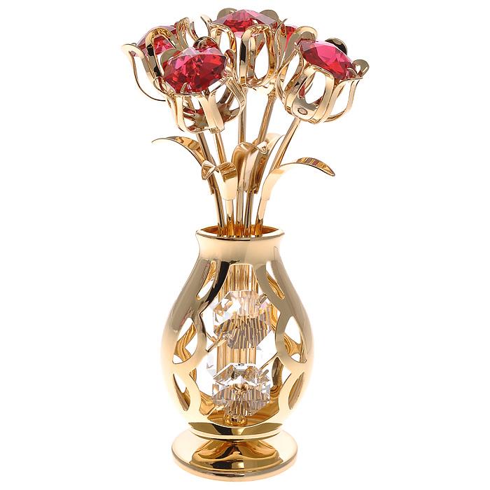Фигурка декоративная Ваза с букетом, цвет: золотистый67442Декоративная фигурка Ваза с букетом, золотистого цвета, станет необычным аксессуаром для вашего интерьера и создаст незабываемую атмосферу. Фигурка в виде вазы с пятью тюльпанами инкрустирована красными и белыми кристаллами. Кристаллы, украшающие фигурку, носят громкое имя Swarovski. Ограненные, как бриллианты, кристаллы блистают сотнями тысяч различных оттенков. Эта очаровательная фигурка послужит отличным функциональным подарком, а также подарит приятные мгновения и окунет вас в лучшие воспоминания. Фигурка упакована в подарочную коробку. Характеристики: Материал: металл (углеродистая сталь, покрытие золотом 0,05 микрон), австрийские кристаллы. Размер фигурки: 5 см х 5 см х 10,5 см. Цвет: золотистый. Размер упаковки: 8,5 см х 13 см х 8,5 см. Артикул: 67442. Более чем 30 лет назад компания Crystocraft выросла из ведущего производителя в перспективную торговую марку, которая задает тенденцию благодаря безупречному чувству...
