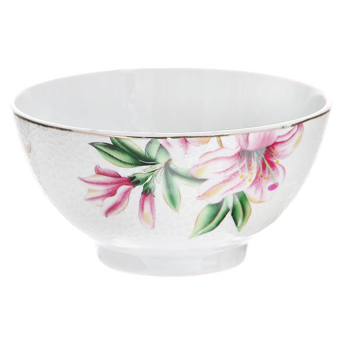 Пиала Розовая лилия, цвет: белый, диаметр 11 см545-480Пиала Розовая лилия, выполненная из высококачественного фарфора, оформлена изящным изображением розовой лилии. Пиала - это небольшая чашка без ручек, которая применялась уже со второй половины 1-го тысячелетия до нашей эры. Особо широкое распространение пиалы получили в Средней Азии, где их используют в чайных церемониях и для подачи риса. В России пиалы также широко используются. Характеристики: Материал: фарфор. Цвет: белый. Диаметр пиалы по верхнему краю: 11 см. Высота пиалы: 5,5 см. Размер упаковки: 12 см х 11,5 см х 6 см. Артикул: 545-480.