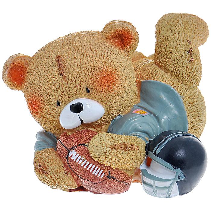 Декоративная копилка Мишка. 2937929379Оригинальная копилка Мишка, выполненная из полирезины в виде медведя-регбиста, станет великолепным украшением интерьера и вызовет улыбку у каждого, кто ее увидит. Деньги из копилки вынимаются при помощи резинового клапана, расположенного на дне копилки. Копилка - это оригинальный и нужный подарок на все случаи жизни. Характеристики: Материал: полирезина. Размер копилки: 15 см x 8 см x 12,5 см. Размер упаковки: 12 см x 13 см x 11 см. Артикул: 29379.