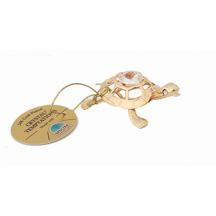 Фигурка декоративная Черепаха, цвет: золотистый. 424946424946Декоративная фигурка Черепаха выполнена из металла золотистого цвета и украшена белыми кристаллами Swarovski. Поставьте фигурку на стол в офисе или дома и наслаждайтесь блеском кристаллов и изящными формами. Изысканный и эффектный, этот сувенир покорит своей красотой и изумительным качеством исполнения, а также станет замечательным подарком. Характеристики: Материал: металл, кристаллы Swarovski. Размер фигурки: 4 см х 5,5 см х 2 см. Цвет: золотистый. Размер упаковки: 6,5 см х 7 см х 3,5 см. Артикул: 424946.