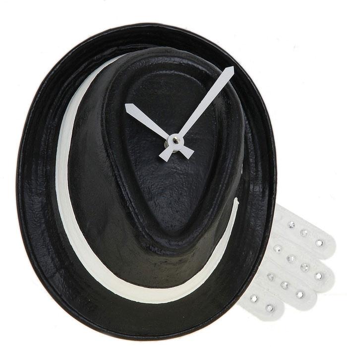 Часы настенные Шляпа, цвет: черный. 652519652519Оригинальные настенные часы Шляпа - интерьерный арт-объект, выполненный вручную итальянскими мастерами из экологически чистого материала - мраморной крошки. Часы оснащены немецким кварцевым механизмом. Висящая на стене классическая черная шляпа - необычное дизайнерское решение и стильное украшение интерьера. Этот аксессуар не только оформит интерьер, но и послужит функционально. Оформите совой дом таким интерьерным шедевром или преподнесите его в качестве презента друзьям, и они оценят ваш оригинальный вкус и неординарность подарка. Характеристики: Материал: мраморная крошка. Артикул: 652519.