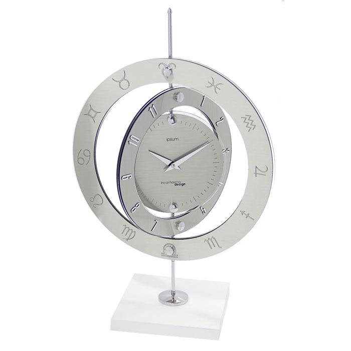 Часы настольные Три плоскости, кварцевые. 654268654268Оригинальные настольные часы Три плоскости выполнены из синтетического стекла и представляют собой стойку на подставке с круглым диском и двумя вращающимися вокруг него кольцами. Циферблат оформлен двумя стрелками часовой и минутной и делениями, обозначающие секунды. На первом кольце нанесены цифры, на втором - знаки зодиака. На задней стенке расположен блок с часовым механизмом. В набор для самостоятельной сборки часов входит: стойка с циферблатом и вращающимися кольцами, подставка, шестигранный ключ и инструкция по сборке. Необычное дизайнерское решение и качество исполнения придутся по вкусу каждому. Оформите совой дом таким интерьерным аксессуаром или преподнесите его в качестве презента друзьям, и они оценят ваш оригинальный вкус и неординарность подарка. Характеристики: Материал: синтетическое стекло, металл, пластик. Тип механизма: плавающий, бесшумный. Размер часов (в собранном виде): 49 см х 33 см х 17 см. Диаметр основного...