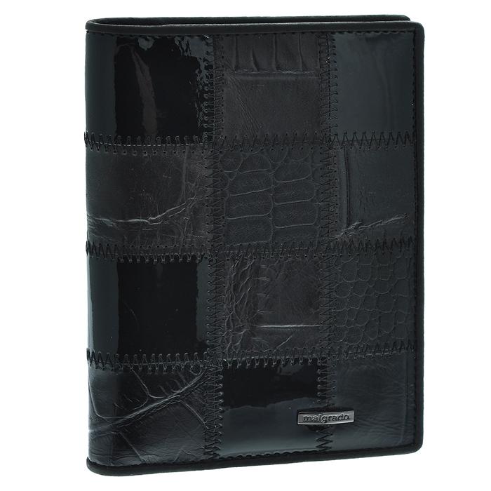 Обложка для паспорта Malgrado, цвет: черный. 54019-1A-239A54019-1A-239AСтильная обложка для паспорта Malgrado изготовлена из натуральной кожи черного цвета с декоративным тиснением под разные структуры и оформлена декоративными стежками. Внутри содержит прозрачное пластиковое окно, съемный прозрачный вкладыш для полного комплекта автодокументов, пять отделений для кредитных и дисконтных карт. Обложка упакована в подарочную картонную коробку с логотипом фирмы. Такая обложка станет замечательным подарком человеку, ценящему качественные и практичные вещи.