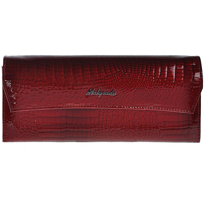 Кошелек женский Malgrado, цвет: красный. 75504-44#75504-44# Red Кошелек Бол. MalgradoСтильный кошелек Malgrado выполнен из лаковой натуральной кожи красного цвета с декоративным тиснением под рептилию, застегивается клапаном на кнопку. Внутри содержит два горизонтальных кармана для бумаг, девять кармашков для кредитных карт, отделение на молнии для мелочи и два отделения для купюр. На задней стороне кошелька расположен открытый кармашек. Кошелек упакован в подарочную металлическую коробку с логотипом фирмы. Такой кошелек станет замечательным подарком человеку, ценящему качественные и практичные вещи.