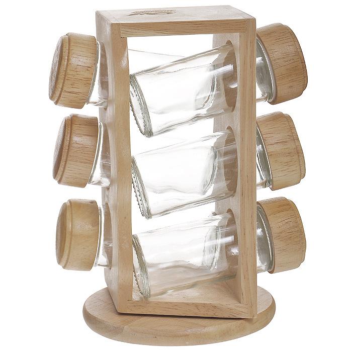 Набор для специй Oriental way, 7 предметов. S4036WS4036WНабор для специй Oriental way представляет собой вращающуюся полку с шестью стеклянными емкостями. Подставка изготовлена из дерева гевея. Емкости для специй, выполненные из стекла, имеют перфорированную пластиковую накладку и завинчивающуюся деревянную крышку. Особенности набора Oriental way: высокое качество шлифовки поверхности изделий; двухслойное покрытие пищевым лаком, безопасным для здоровья человека; степень влажности 8-10%, не трескается и не рассыхается; высокая плотность структуры древесины; устойчивость к механическим воздействиям.