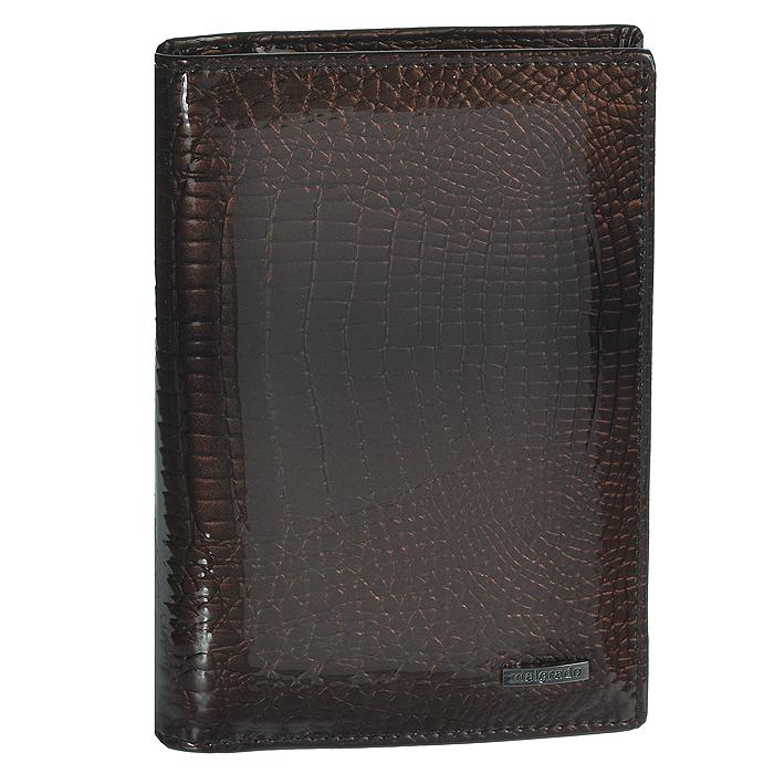 Обложка для паспорта и автодокументов Malgrado, цвет: коричневый. 54019-1-0141154019-1-01411# Coffee Обложка Д. Паспорта MalgradoОбложка для паспорта и автодокументов Malgrado не только поможет сохранить внешний вид ваших документов и защитить их от повреждений, но и станет стильным аксессуаром, идеально подходящим вашему образу. Обложка выполнена из натуральной лаковой кожи высокого качества. На внутреннем развороте имеются пять наборных кармашков для кредиток или визитных карточек, съемный блок из шести прозрачных файлов из мягкого пластика, один из которых формата А5 и вертикальный карман из прозрачного пластика. Обложка упакована в фирменную картонную коробку.