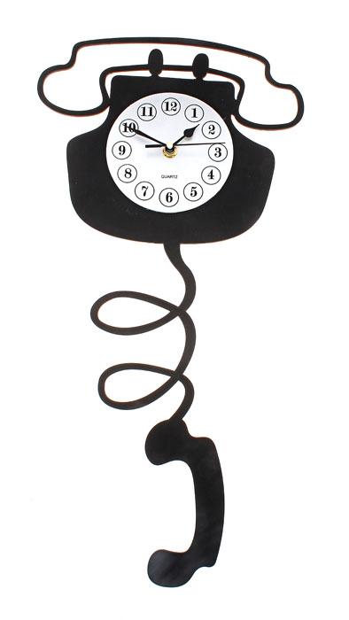 Часы настенные Телефон, кварцевые. 670815670815Настенные кварцевые часы Sima-land - это прекрасный предмет декора, а также универсальный подарок практически по любому поводу. Корпус часов, выполнен из пластика с черным покрытием в виде телефона. Циферблат часов оснащен тремя стрелками: часовой, минутной и секундной, покрыт серебристым напылением и оформлен черными арабскими цифрами. Циферблат и стрелки не защищены стеклом. На задней стенке часов расположена пластиковая петелька для подвешивания и блок с часовым механизмом. Такие часы впишутся в любой интерьер. Характеристики: Материал: пластик. Тип механизма: плавающий, бесшумный. Размер часов: 52 см х 25 см х 3 см. Толщина корпуса часов: 3 см. Диаметр циферблата: 12 см. Размер упаковки: 56 см х 26 см х 5 см. Рекомендуется докупить батарейку типа АА (не входит в комплект).
