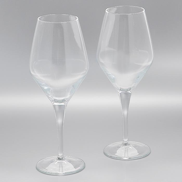Набор фужеров Dream, 670 мл, 2 шт44571Набор Dream, выполненный из высококачественного стекла, состоит из 2 фужеров на высоких ножках. Они выполнены в оригинальном элегантном дизайне. Благодаря такому набору пить напитки будет еще вкуснее. Фужеры станут идеальным украшением праздничного стола и отличным подарком к любому празднику. Характеристики: Материал: натрий-кальций-силикатное стекло. Комплектация: 2 шт. Объем: 670 мл. Диаметр фужера по верхнему краю: 6,5 см. Диаметр основания: 8,5 см. Высота фужера: 26 см. Размер упаковки: 21 см х 10,5 см х 26,5 см. Артикул: 44571.