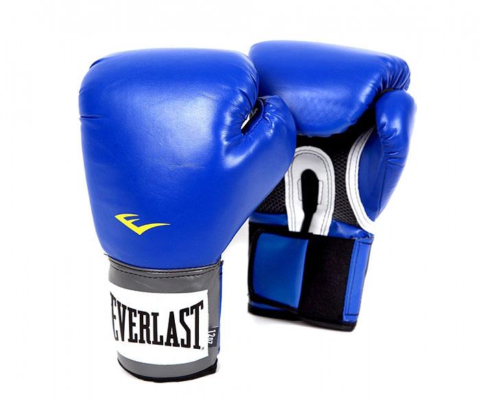 Перчатки тренировочные Everlast Pro Style, цвет: синий, 12 унций. 2212U2212UТренировочные боксерские Pro Style Training Gloves перчатки. Высококачественный кожзаменитель наряду с превосходным дизайном гарантируют качество, долговечность и функциональность перчаток. Мелкие отверстия по всей площади ладони позволяют коже дышать
