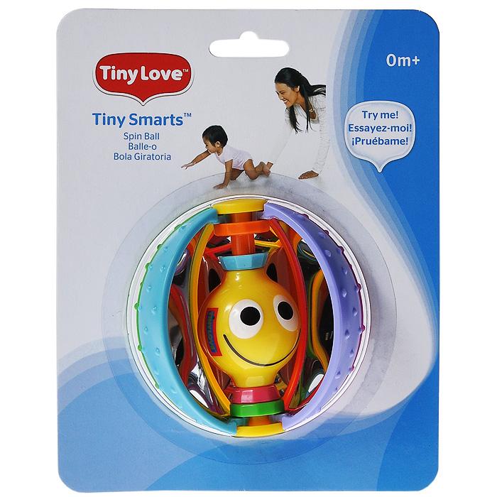 Развивающая игрушка-погремушка Tiny Love Волшебный шарик4101002Развивающая игрушка-погремушка Tiny Love Волшебный шарик выполнена в виде шара, состоящего из восьми элементов разных цветов, которые свободно перемешаются вокруг оси. Внешняя поверхность цветных элементов покрыта маленькими выпуклыми точками, которые стимулируют нервные окончания на пальчиках вашего малыша. С внутренней стороны элементы шара зеркальные. На оси шара расположен двусторонний шарик с улыбающимися мордочками, который может перемещаться вверх-вниз и вращаться вокруг оси. Внутри шарика находятся мелкие гранулы, гремящие при вращении или тряске. Форма игрушки-погремушки удобна для маленьких детских ручек. Малыш сможет ее держать, трясти и перекладывать из одной ручки в другую. Игрушка-погремушка Волшебный шарик способствует развитию у ребенка цветового и звукового восприятия, тактильных ощущений, мелкой моторики рук.
