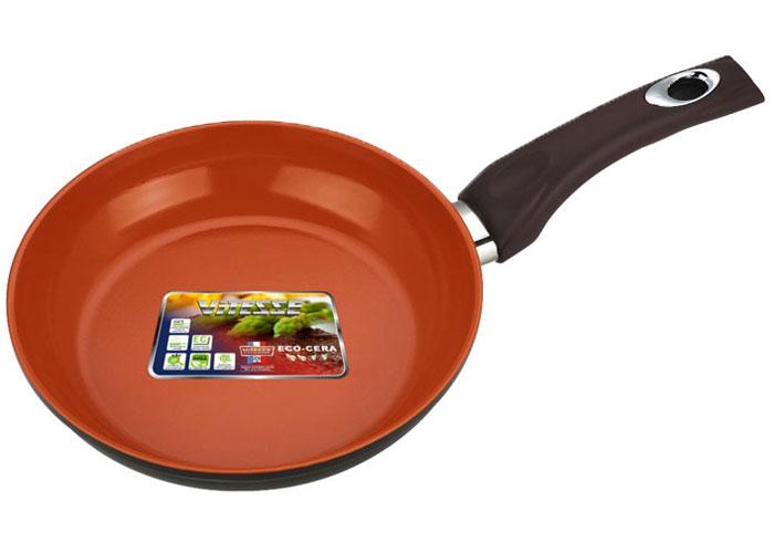 Сковорода Vitesse Cherry, цвет: коричневый. Диаметр 20 смVS-2278Сковорода Vitesse Cherry изготовлена из высококачественного алюминия. Внутреннее керамическое покрытие Eco-Cera, позволяющее готовить при высоких температурах, не оставляет послевкусия, делает возможным приготовление блюд без масла, сохраняет витамины и питательные вещества. Высокотехнологичное внешнее антипригарное покрытие коричневого цвета устойчиво к царапинам и механическим повреждениям. Покрытие безопасно для человека, не содержит PFOA. Утолщенное алюминиевое дно обеспечивает равномерное распределение тепла по поверхности. Сковорода снабжена удобной и высокопрочной ручкой из бакелита, которая не нагревается в процессе приготовления пищи. Сковорода Vitesse подходит для использования на всех типах кухонных плит, кроме индукционных. Можно мыть в посудомоечной машине. Можно использовать металлическую лопатку.