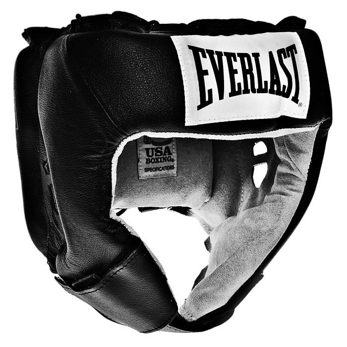 Шлем боксерский Everlast USA Boxing, тренировочный, цвет: черный. Размер L610401UТренировочный боксерский шлем Everlast USA Boxing черного цвета предназначен для предохранения головы от жестких ударов, травмирования бровей, ушей и лица. Внешняя поверхность шлема выполнена из натуральной кожи, внутренняя поверхность - из замши. Шлем обеспечивает защиту в области лба, ушей и скул, а также создает дополнительный комфорт за счет анатомической подушки в тыльной части. Шлем регулируется по ширине в верхней части и прочно фиксируется на голове при помощи шнуровки. На подбородке шлем застегивается на прочную застежку на липучке. Такой шлем погасит силу ударов и надежно защитит все зоны головы от повреждений.