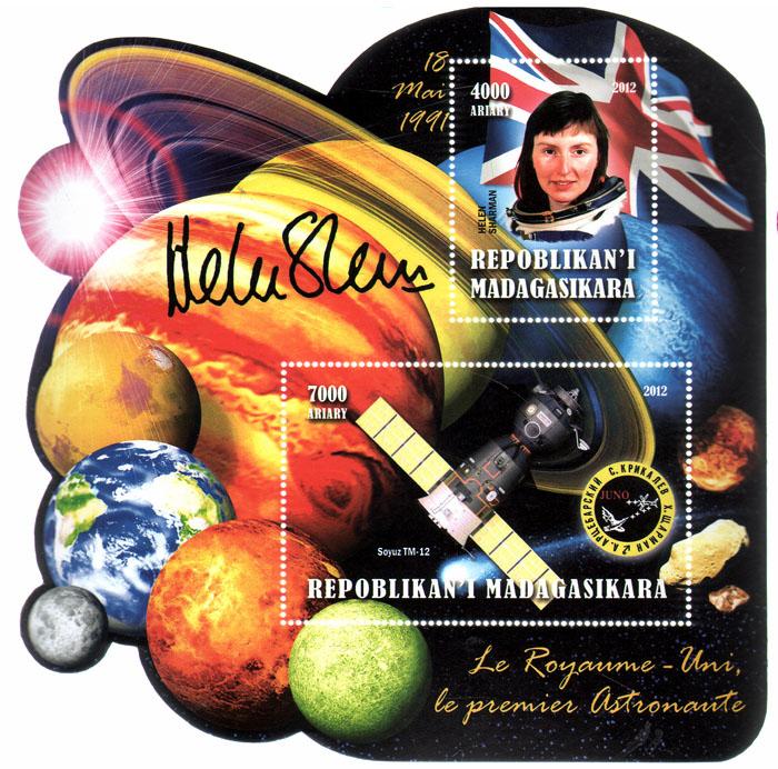 Почтовый блок Первый космонавт Великобритании. Мадагаскар. 2012 годL2070 EПочтовый блок Первый космонавт Великобритании. Мадагаскар. 2012 год. Размер блока 14,5 х 14,5 см. Размер марок 8 х 5 см, 5 х 4 см. Сохранность хорошая.
