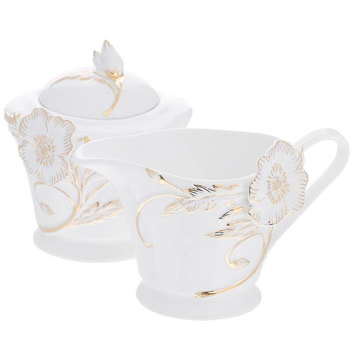 Набор Золотой цветок, 2 предмета595-153Набор Золотой цветок состоит из сахарницы и молочника, выполненных из высококачественного фарфора белого цвета. Изделия декорированы рельефным цветком, покрытым золотистой эмалью. Такой набор прекрасно подойдет для сервировки стола и станет незаменимым атрибутом чаепития. Набор упакован в подарочную коробку из плотного золотистого картона. Внутренняя часть коробки задрапирована белой атласной тканью, и каждый предмет надежно крепится в определенном положении благодаря особым выемкам в коробке. Характеристики: Материал: фарфор. Объем молочника: 200 мл. Размер молочника (Д х Ш х В): 14 см х 9 см х 8 см. Объем сахарницы: 250 мл. Диаметр сахарницы: 9,5 см. Высота сахарницы (с учетом крышки): 10,5 см. Размер упаковки: 26 см х 13,5 см х 10,5 см. Артикул: 595-153.
