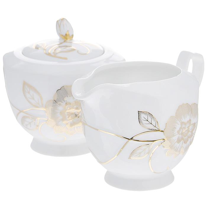 Набор Золотая соната, 2 предмета595-022Набор Золотая соната состоит из сахарницы и молочника, выполненных из высококачественного фарфора белого цвета. Изделия декорированы рельефным золотистым цветком. Такой набор прекрасно подойдет для сервировки стола и станет незаменимым атрибутом чаепития. Набор упакован в подарочную коробку из плотного золотистого картона. Внутренняя часть коробки задрапирована белой атласной тканью, и каждый предмет надежно крепится в определенном положении благодаря особым выемкам в коробке.