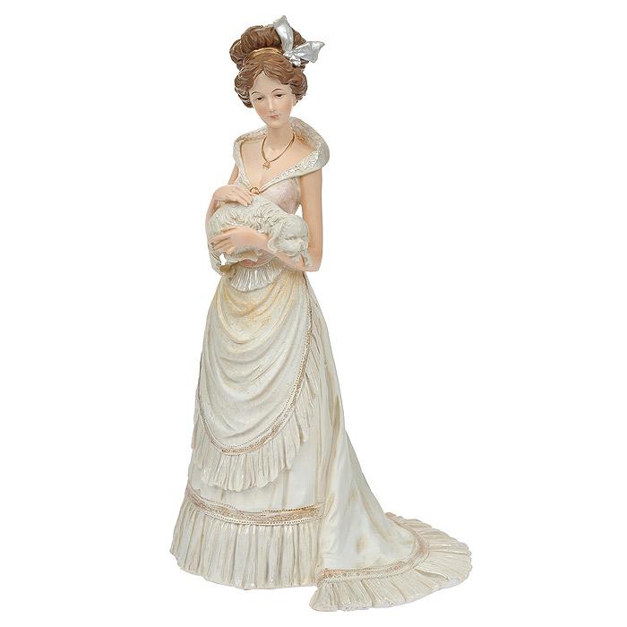 Статуэтка Мадам с собакой, высота 33 см514-1012Статуэтка Мадам с собакой, выполненная из полистоуна, станет отличным украшением интерьера вашего дома или офиса. Статуэтка выполнена в виде дамы в роскошном белом платье с собачкой в руках. Вы можете поставить статуэтку в любом месте, где она будет удачно смотреться, и радовать глаз. Также она может стать оригинальным подарком для всех любителей стильных вещей. Характеристики: Материал: полистоун. Размер статуэтки (Ш х Д х В): 18 см х 16 см х 33 см. Размер упаковки: 18,5 см х 20,5 см х 35,5 см. Артикул: 514-1012.
