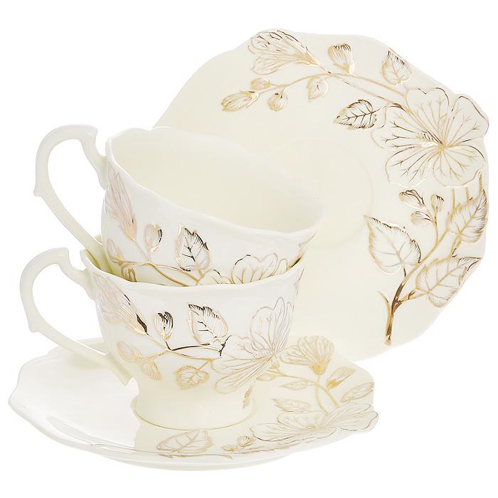 Набор чайный Желтый цветок, 4 предмета595-108Чайный набор Желтый цветок, выполненный из высококачественного фарфора молочного цвета, состоит из двух чашек и двух блюдец. Изделия декорированы рельефным цветком, покрытым золотистой эмалью. Элегантный дизайн и совершенные формы предметов набора привлекут к себе внимание и украсят интерьер вашей кухни. Чайный набор Желтый цветок идеально подойдет для сервировки стола и станет отличным подарком к любому празднику. Чайный набор упакован в подарочную коробку из плотного картона золотистого цвета. Внутренняя часть коробки задрапирована белой атласной тканью, и каждый предмет надежно крепится в определенном положении благодаря особым выемкам в коробке.