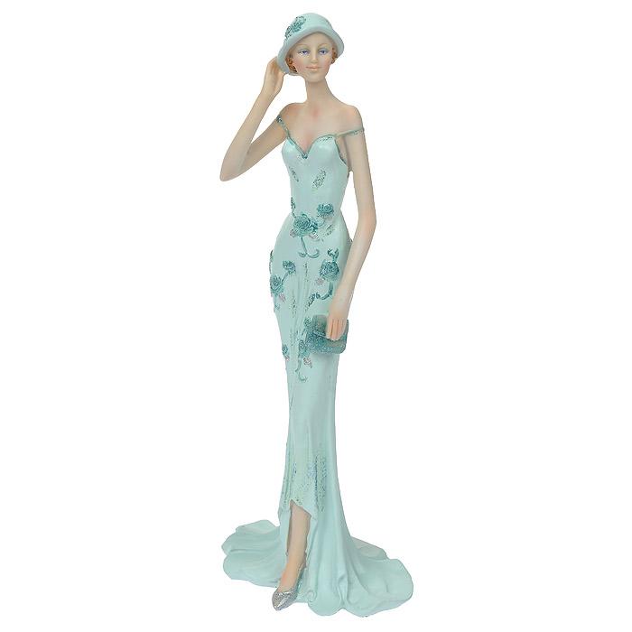 Статуэтка Дама в нежно-голубом, высота 33 см512-118Статуэтка Дама в нежно-голубом, выполненная из полистоуна, станет отличным украшением интерьера вашего дома или офиса. Статуэтка выполнена в виде дамы в изящном платье нежно-голубого цвета. Вы можете поставить статуэтку в любом месте, где она будет удачно смотреться, и радовать глаз. Также она может стать оригинальным подарком для всех любителей стильных вещей. Характеристики: Материал: полистоун. Размер статуэтки (Ш х Д х В): 13 см х 10 см х 33 см. Размер упаковки: 17 см х 14 см х 37 см. Артикул: 512-118.