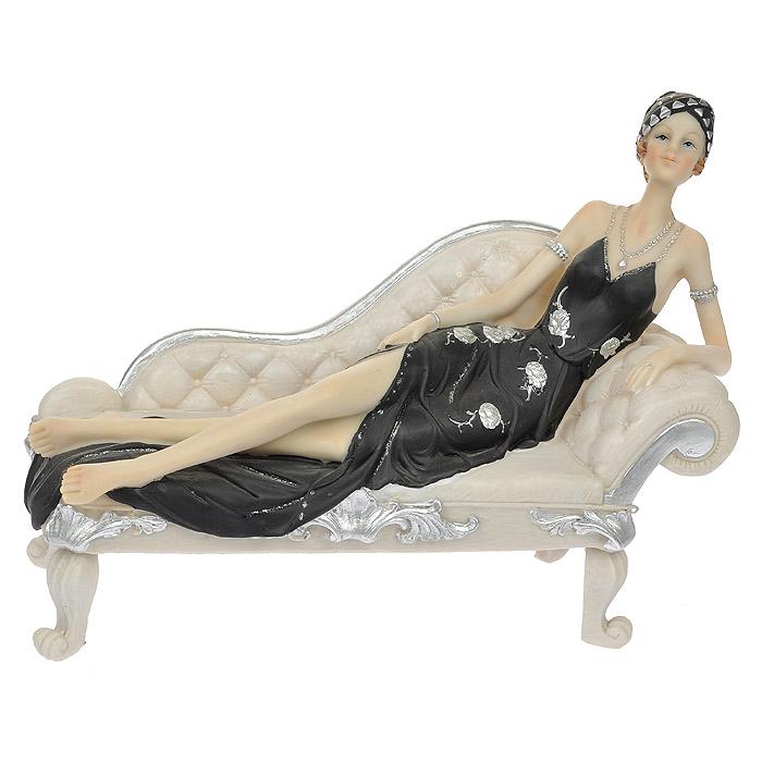 Статуэтка Вечерняя нега, высота 19 см512-117Статуэтка Вечерняя нега, выполненная из полистоуна, станет отличным украшением интерьера вашего дома или офиса. Статуэтка выполнена в виде изящной дамы в черном платье, лежащей на тахте. Вы можете поставить статуэтку в любом месте, где она будет удачно смотреться, и радовать глаз. Также она может стать оригинальным подарком для всех любителей стильных вещей.