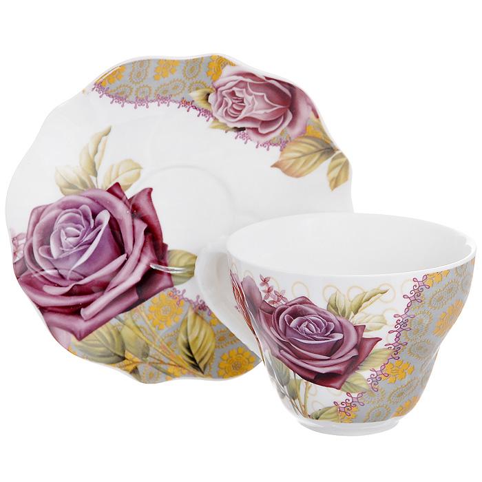 Набор чайный Розы на орнаменте, 2 предмета516-065Чайный набор Розы на орнаменте, выполненный из высококачественного фарфора, состоит из чашки и блюдца. Изделия декорированы изображением роз. Элегантный дизайн и совершенные формы предметов набора привлекут к себе внимание и украсят интерьер вашей кухни. Чайный набор Розы на орнаменте идеально подойдет для сервировки стола и станет отличным подарком к любому празднику. Чайный набор упакован в подарочную коробку с бантом.