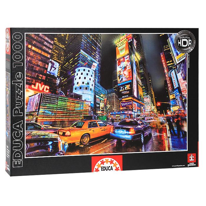 Таймс-Сквер. Пазл, 1000 элементов15525Пазл Таймс-Сквер, без сомнения, придется вам по душе. Собрав этот пазл, включающий в себя 1000 элементов, вы получите великолепную цветную картину с изображением знаменитой площади Нью-Йорка Таймс-Сквер (англ. Times Square) в ночное время. В комплект входит специальный клей, представляющий собой порошок, который перед применением требуется развести водой. Он надежно склеивает собранный пазл и не оставляет следов на поверхности картинки. Пазлы - прекрасное антистрессовое средство для взрослых и замечательная развивающая игра для детей. Собирание пазла развивает у ребенка мелкую моторику рук, тренирует наблюдательность, логическое мышление, знакомит с окружающим миром, с цветом и разнообразными формами, учит усидчивости и терпению, аккуратности и вниманию. Собирание пазла - прекрасное времяпрепровождение для всей семьи.