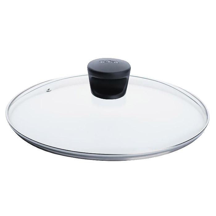 Крышка стеклянная Tefal. Диаметр 28 см040 90 128Крышка Tefal изготовлена из термостойкого стекла. Обод, выполненный из высококачественной нержавеющей стали, защищает крышку от повреждений, а ручка, выполненная из термостойкого пластика, защищает ваши руки от высоких температур. Крышка удобна в использовании, позволяет контролировать процесс приготовления пищи. Имеется отверстие для выпуска пара.