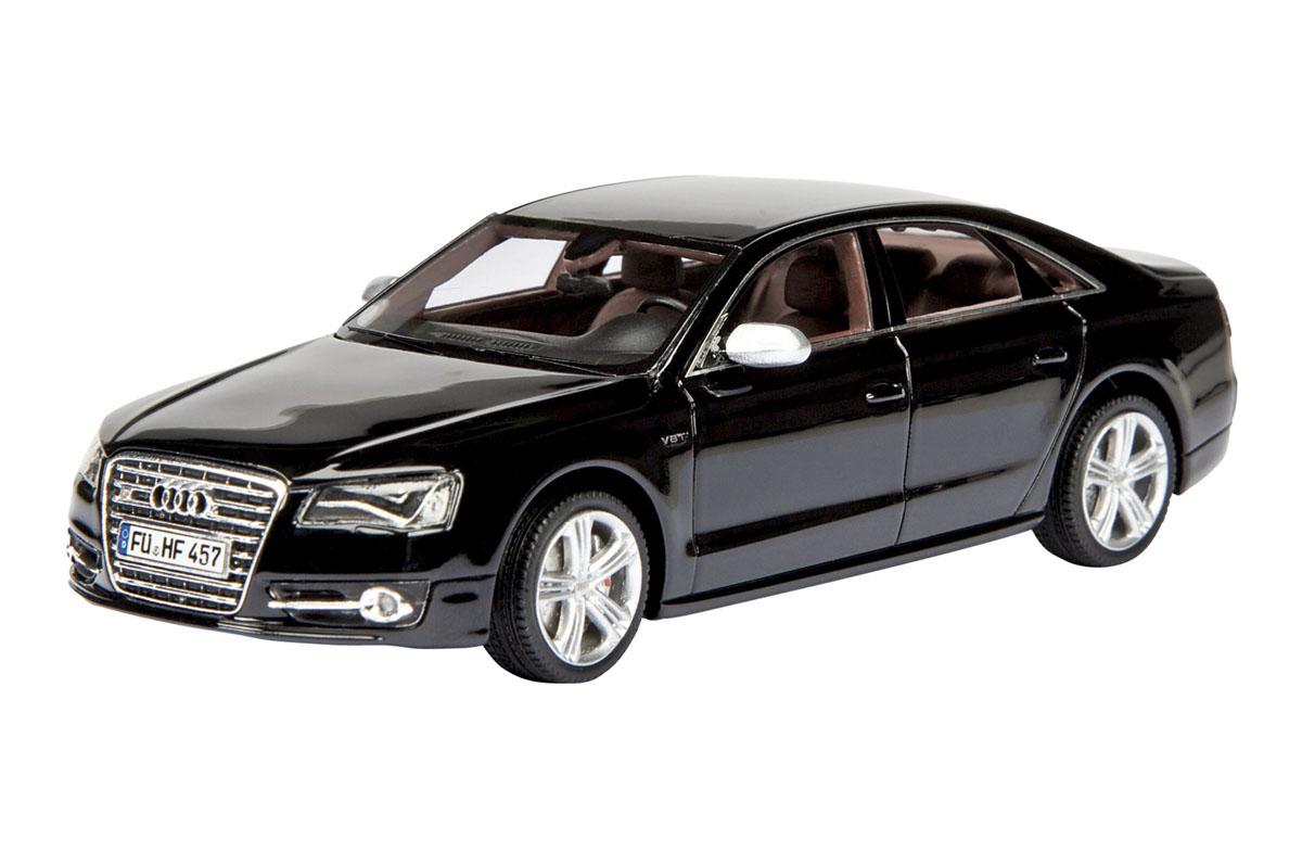 Schuco Модель автомобиля Audi S8, цвет: брилиантовый-черный. Масштаб 1/43450885100Стильная модель автомобиля Audi S8 привлечет внимание не только ребенка, но и взрослого. Модель является точной уменьшенной копией автомобиля компании Audi. Корпус выполнен из цинка и пластика, колеса крутятся. Такая модель станет отличным подарком не только любителю автомобилей, но и человеку, ценящему оригинальность и изысканность, а качество исполнения представит такой подарок в самом лучшем свете.