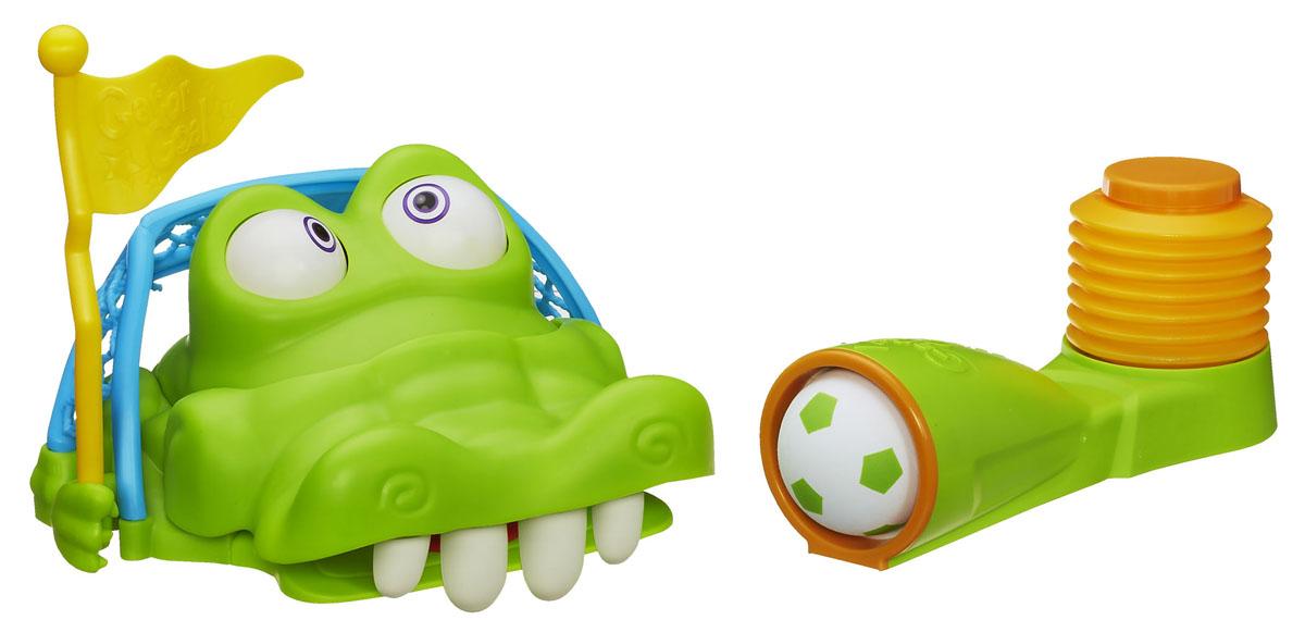 Настольная игра Elefun and Friends Гол КрокодильчикаA3053Стань настоящим футболистом с Крокогол! Игра Гол Крокодильчика не оставит равнодушным ни одного ребенка. В нее можно играть одному или компанией друзей. Цель игры - забить в рот гаторифика мячик раньше своих соперников. Для этого необходимо положить гаторифика на землю, затем потянуть назад флажок, тем самым открыв рот игрушки и обнажив четыре зуба. Далее следует вставить мяч в пусковой механизм, прицелиться в зубы гаторифика и наступить ногой на спуск. Выигрывает игрок, после броска которого гаторифик начинает вращать глазами. В комплект игры входят: игрушка в виде гаторифика (крокодила), пусковой механизм, флажок, мяч, стилизованный под футбольный, и правила игры на русском языке.