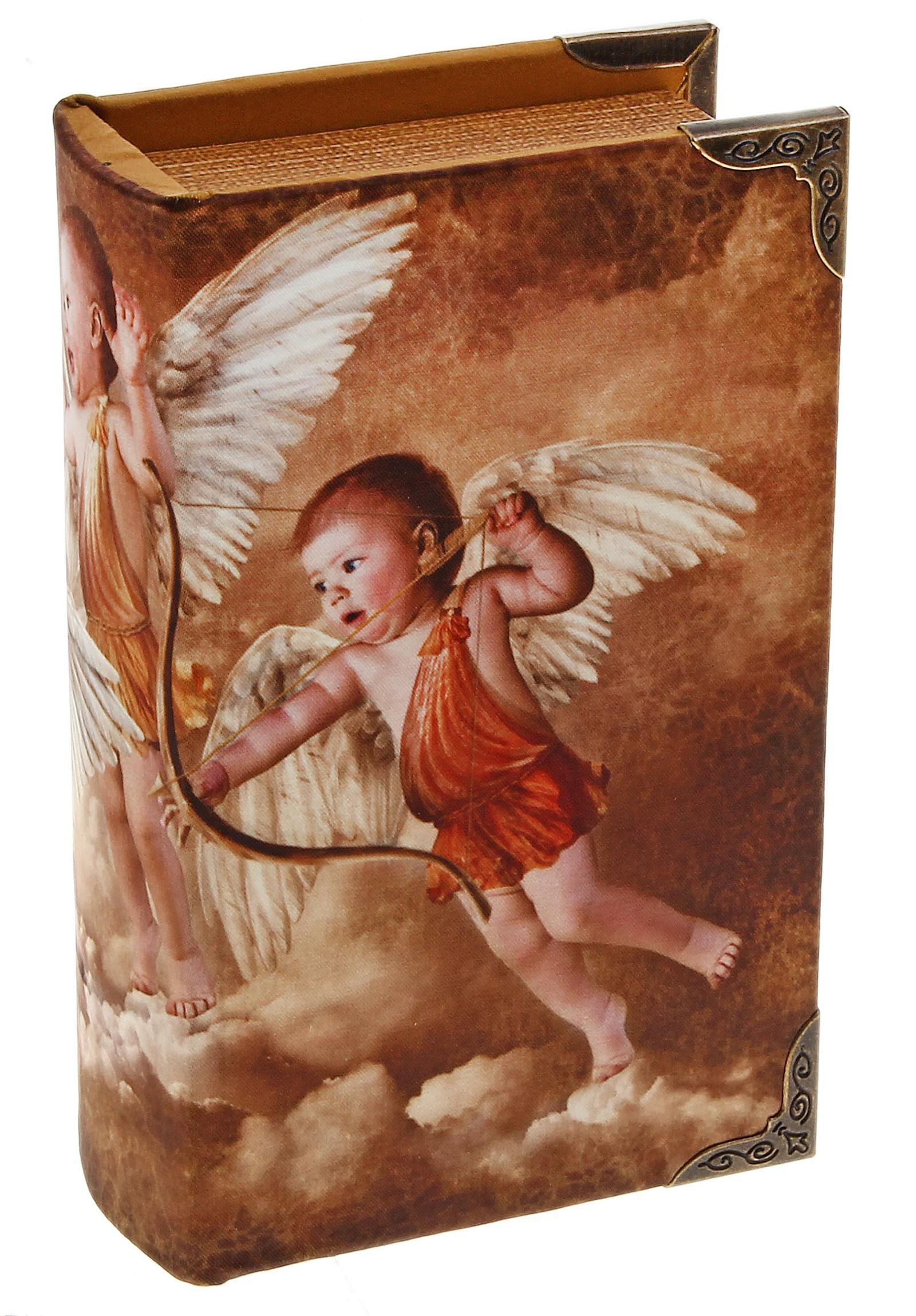 Шкатулка-книга Игры ангелов521770Оригинальное оформление шкатулки, несомненно, привлечет внимание. Шкатулка Игры ангелов изготовлена в виде старинной книги. Поверхность шкатулки выполнена из кожзаменителя и оформлена изображением ангелов. Такая шкатулка может использоваться для хранения бижутерии, в качестве украшения интерьера, а также послужит хорошим подарком для человека, ценящего практичные и оригинальные вещи. Характеристики: Материал: дерево, кожзам, металл. Цвет: коричневый. Размер шкатулки (в закрытом виде): 17 см х 11 см х 5 см. Размер упаковки: 18 см х 12 см х 6 см. Артикул: 521770.