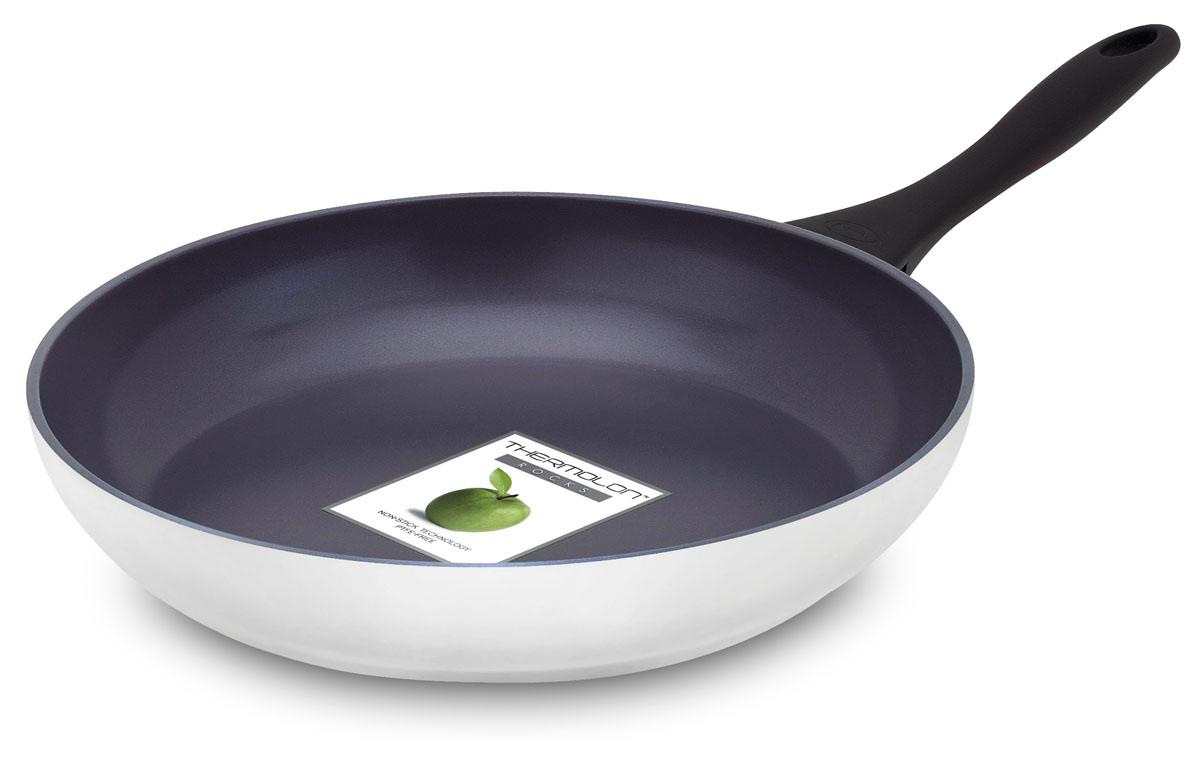 Сковорода GreenPan Kyoto, с антипригарным покрытием, цвет: белый, серый. Диаметр 26 смCW0001844Сковорода GreenPan Kyoto, изготовленная из алюминия с уникальным керамическим антипригарным покрытием Thermolon, станет незаменимым помощником на кухне. Особенности сковороды GreenPan Kyoto: - устойчивое к высоким температурам сверхпрочное керамическое покрытие Thermolon обеспечивает долгий срок службы посуды, устойчиво к царапинам, - утолщенное кованое дно способствует равномерному распределению тепла, - возможность безопасно готовить при высоких температурах (до 450°С), - эргономичная мягкая на ощупь ненагревающаяся бакелитовая ручка Soft Touch, - толстые алюминиевые стенки и внешнее покрытие Thermolon для легкого мытья, - благодаря наличию впрессованного стального диска подходит для использования на всех типах плит, включая индукционные. При производстве покрытия не используется перфтороктановая кислота (PFOA) и покрытие не содержит PTFE, во время готовки оно не вступает в реакцию с продуктами, не выделяет токсические...