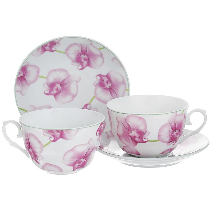 Набор чайный Орхидеи, 4 предмета532-124Чайный набор Орхидеи состоит из двух чашек и двух блюдец, выполненных из высококачественного фарфора. Предметы набора оформлены изображением розовых орхидей. Изящный дизайн придется по вкусу и ценителям классики, и тем, кто предпочитает утонченность и изысканность. Он настроит на позитивный лад и подарит хорошее настроение с самого утра. Набор упакован в красочную подарочную коробку. Внутренняя часть коробки задрапирована белой атласной тканью. Каждый предмет надежно зафиксирован внутри коробки благодаря специальным выемкам.
