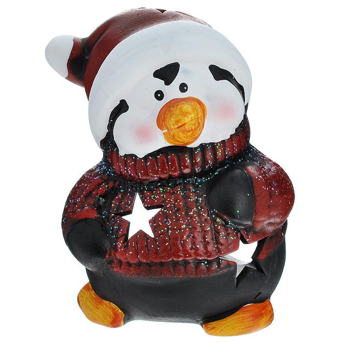 Подсвечник Пингвин, цвет: темно-красный, черный. 119315119315Подсвечник Пингвин для чайной свечи выполнен из керамики, украшенной блестками. По всей поверхности имеются отверстия в виде звезд, благодаря которым при горении свечи в комнате будет создаваться притягательное и завораживающее мерцание. Новогодние украшения приносят в дом волшебство и ощущение праздника. Создайте в своем доме атмосферу веселья и радости.