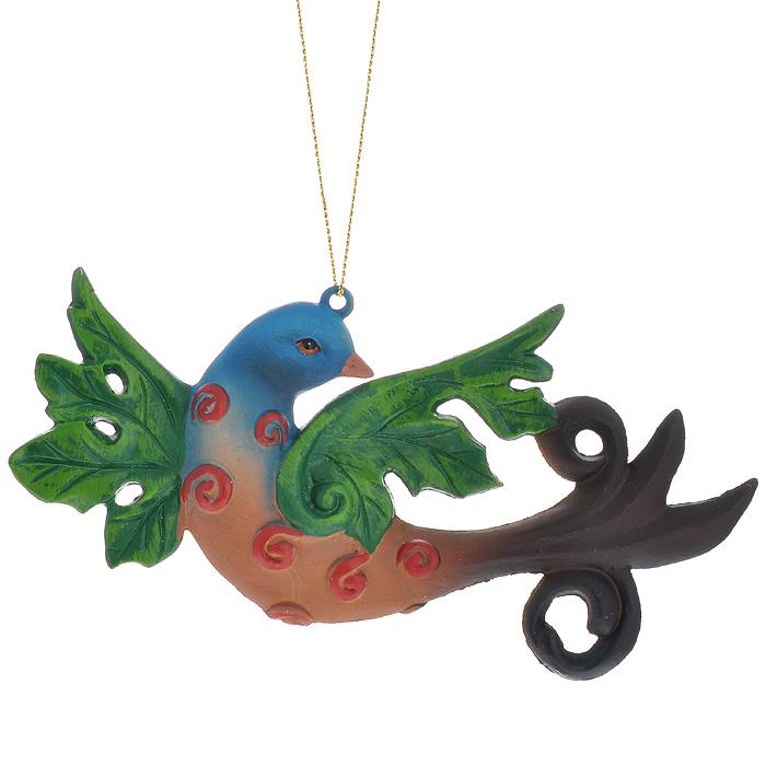 Новогоднее подвесное украшение Птица, цвет: синий, зеленый, коричневый. 2587525875Оригинальное новогоднее украшение выполнено из пластика в виде разноцветной птицы. С помощью специальной петельки украшение можно повесить в любом понравившемся вам месте. Но, конечно же, удачнее всего такая игрушка будет смотреться на праздничной елке. Новогодние украшения приносят в дом волшебство и ощущение праздника. Создайте в своем доме атмосферу веселья и радости, украшая всей семьей новогоднюю елку нарядными игрушками, которые будут из года в год накапливать теплоту воспоминаний. Коллекция декоративных украшений из серии Magic Time принесет в ваш дом ни с чем несравнимое ощущение волшебства!