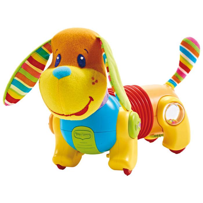 Развивающая игрушка Tiny Love Догони меня: Собачка Фрэд, цвет: желтый, оранжевый, голубой, красный1502406830Развивающая игрушка Tiny Love Догони меня: Собачка Фрэд не оставит равнодушным вашего малыша. Игрушка представляет собой собачку, голова и хвост которой выполнены из приятного на ощупь текстильного материала, туловище - из пластика. Ушки собачки шуршат. На задних лапках располагаются встроенные прозрачные вставки-погремушки, задняя стенка которых представляет собой зеркало. На передних лапках собачки находятся кнопки, при нажатии на которые зазвучит веселая музыка. Игрушка снабжена четырьмя колесиками с ограничителем скорости на одном из них, благодаря которым малыш может катать игрушку, наблюдая, как крутятся шарики внутри погремушек. Часть туловища собачки представляет собой вставку-гармошку, которая позволяет осуществлять движение по прямой или по кругу. Развивающая игрушка Tiny Love Догони меня: Собачка Фрэд волшебным образом поднимет настроение вашего малыша, побуждая ползать за ней, а также поможет ему в развитии цветового и звукового восприятия, мелкой...