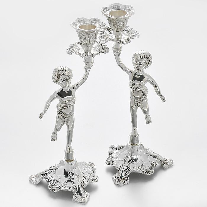 Набор декоративных подсвечников Marquis Ангелы, 2 шт. 1051-MR1051-MRНабор Marquis Ангелы состоит их двух декоративных подсвечников, выполненных из стали с серебряно-никелевым покрытием. Подсвечники стилизованы под старину и предназначены для тонких классических свечей. Ножки подсвечников оформлены фигурками ангелов. Такие подсвечники позволят вам украсить интерьер дома или рабочего кабинета оригинальным образом. С таким набором вы сможете не просто внести в интерьер своего дома элемент необычности, но и создать атмосферу загадочности и изысканности. Характеристики: Материал: сталь с серебряно-никелевым покрытием. Комплектация: 2 шт. Цвет: серебристый. Высота подсвечника: 24 см. Размер основания: 9,5 см х 9,5 см. Диаметр углубления для свечи: 2,2 см. Размер упаковки: 14 см х 10 см х 26 см. Артикул: 1051-MR.