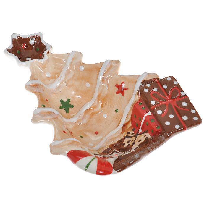 Блюдо Елка, 20 см х 14,5 см х 4,5 смYM121187A/CБлюдо Елка выполнено из высококачественного фаянса. Блюдо изготовлено в форме праздничной елки, украшенной игрушками, подарками и звездой на вершине. Данное блюдо сочетает в себе оригинальный дизайн с максимальной функциональностью. Красочность оформления особенно подойдет для новогоднего торжества.
