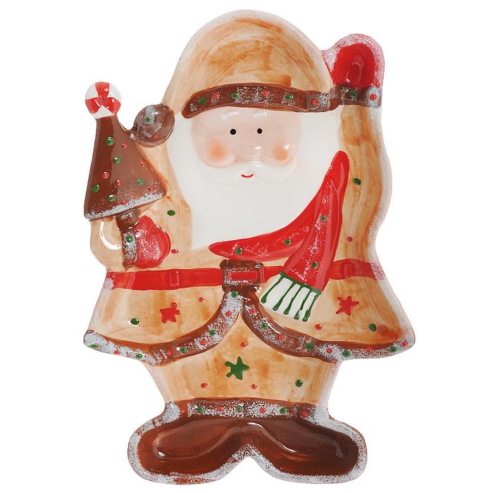 Блюдо Дед Мороз, 25,5 х 17,5 х 3 смYM121171-2CБлюдо Дед Мороз выполнено из высококачественного фаянса. Блюдо изготовлено в виде Деда Мороза с елочкой в руке. Данное блюдо сочетает в себе оригинальный дизайн с максимальной функциональностью. Красочность оформления особенно подойдет для новогоднего торжества. Характеристики: Материал: фаянс. Размер блюда (Д х Ш х В): 25,5 см х 17,5 см х 3 см. Размеры упаковки: 26 см х 18 см х 4 см. Артикул: YM121171-2C.