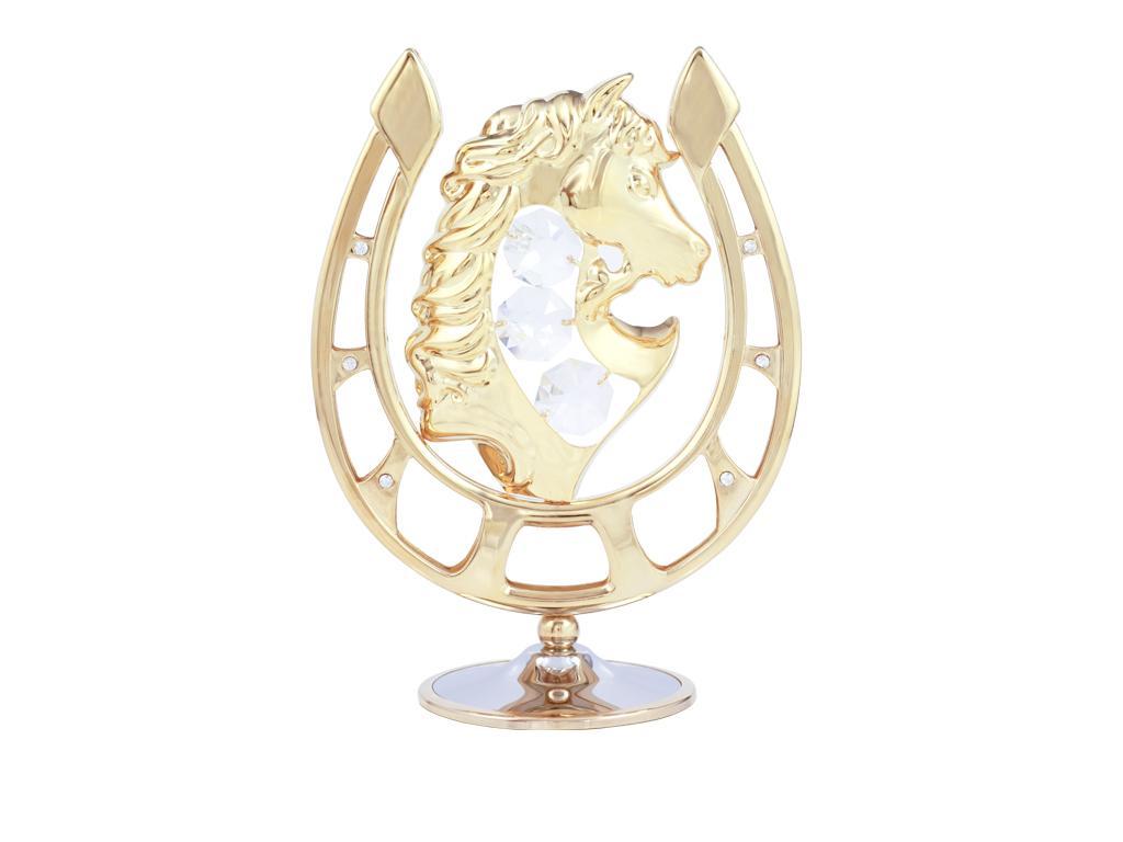 Миниатюра Crystocraft Лошадь в подкове, цвет: золотистыйU0499-191-GC1Миниатюра Лошадь в подкове золотистого цвета станет необычным аксессуаром для вашего интерьера и создаст незабываемую атмосферу. Кристаллы, украшающие сувенир, носят громкое имя Swarovski. Ограненные, как бриллианты, кристаллы блистают сотнями тысяч различных оттенков. Эта очаровательная вещь послужит отличным подарком близкому человеку, родственнику или другу, а также подарит приятные мгновения и окунет вас в лучшие воспоминания. Характеристики: Материал: сталь, австрийские кристаллы. Размер миниатюры: 9 см х 11,5 см х 5 см. Цвет: золотистый. Размер упаковки: 14 см х 10,5 см х 7,5 см. Артикул: U0499-191-GC1. Более чем 30 лет назад компания Crystocraft выросла из ведущего производителя в перспективную торговую марку, которая задает тенденцию благодаря безупречному чувству красоты и стиля. Компания создает изящные, качественные, яркие сувениры, декорированные кристаллами Swarovski различных размеров и оттенков, сочетающие...