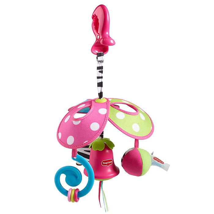 Игрушка-подвеска Tiny Love Веселая карусель: Моя Принцесса1109900458Игрушка-подвеска Tiny Love Веселая карусель: Моя Принцесса предназначена для детей с самого рождения. Благодаря своей яркой расцветке и приятному на ощупь материалу игрушка привлечет внимание малыша и в игровой форме позволит ему развиваться. Игрушка выполнена из безопасных материалов и представляет собой карусель, состоящую из трех лепестков. К лепесткам подвешены мягкий мячик-погремушка, анатомический прорезыватель с тремя колечками, которые малыш сможет передвигать, и шуршащая звездочка с небольшим безопасным зеркальцем круглой формы и тремя короткими шнурочками. В нижней части игрушки к центру подвешен китайский колокольчик с тремя короткими атласными ленточками разных цветов. Колокольчик мелодично звенит каждый раз, когда до него дотрагиваются. Благодаря пластиковой клипсе, прикрепленной к карусели с помощью текстильного шнурка, игрушку можно подвесить к кроватке, коляске, автокреслу или игровой дуге малыша. Яркая игрушка-подвеска Tiny Love Веселая карусель...