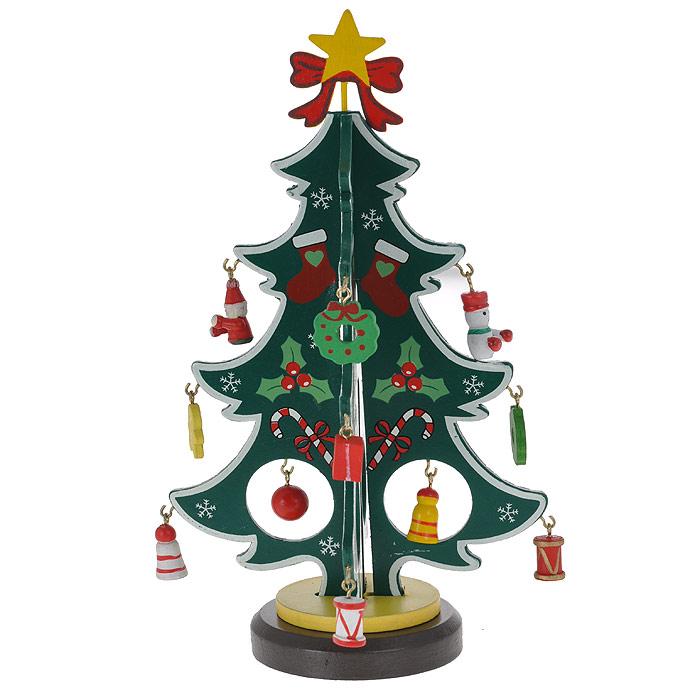 Новогоднее деревянное украшение Новогодняя елка. 2617326173Оригинальное деревянное украшение Новогодняя елка гармонично впишется в праздничный интерьер вашего дома или офиса. Украшение выполнено из дерева в виде елки зеленого цвета, которая устанавливается на подставку. На елке имеются круглые отверстия с небольшими металлическими крючками, благодаря которым на нее можно повесить елочные игрушки, входящие в комплект. Новогодние украшения всегда несут в себе волшебство и красоту праздника. Создайте в своем доме атмосферу тепла, веселья и радости, украшая его всей семьей. Характеристики: Материал: дерево, металл. Размер елки: 15 см х 11,5 см. Размер подставки: 6,5 см х 4 см. 1,5 см. Размер упаковки: 13,5 см х 16,5 см х 2,5 см. Изготовитель: Китай. Артикул: 26173.