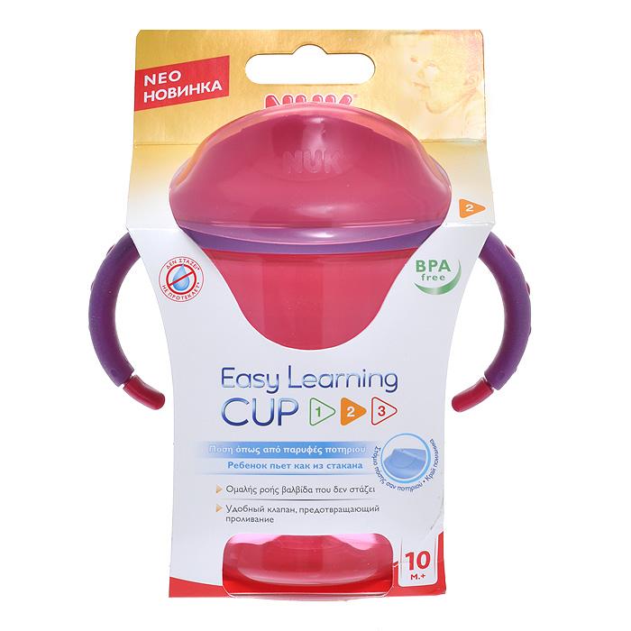 Чашка-поильник NUK Easy Learning, No2, от 10 месяцев, 275 мл, цвет: розовый10 750 596Чашка-поильник NUK Easy Learning, изготовленная из прочного полипропилена, разработана специально для детей от 10 месяцев для легкого перехода от грудного кормления к питью из стакана. Пить из него легко, как из стакана. Поильник имеет мягкий силиконовый клапан, который не протекает, даже если малыш перевернет чашку, и крышку, обеспечивающую гигиеничность. Благодаря эргономичному дизайну и нескользящим ручкам крохе будет удобно держать чашку-поильник. Широкое горлышко позволит легко наполнить и очистить поильник. Чашка-поильник комбинируется со всеми поильниками NUK Easy Learning. Характеристики: Материал: полипропилен, силикон. Рекомендуемый возраст: от 10 месяцев. Объем: 275 мл. Общая высота (с крышкой): 13 см.