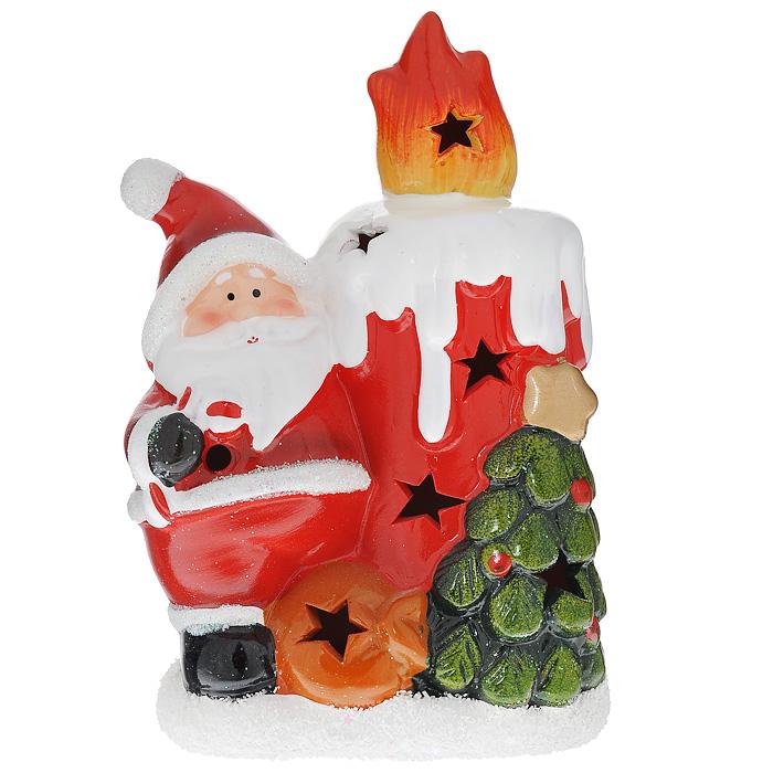 Новогоднее украшение Дед Мороз со свечкой, с подсветкой. 7422674226Новогоднее украшение из керамики Дед Мороз со свечкой с подсветкой украсит интерьер, создаст теплую и уютную атмосферу праздника. На лицевой стороне украшения имеются декоративные отверстия, благодаря которым домик будет светиться изнутри разными цветами при включении подсветки (переключатель находится на нижней панели фигурки). Новогодние украшения всегда несут в себе волшебство и красоту праздника. Создайте в своем доме атмосферу тепла, веселья и радости, украшая его всей семьей.