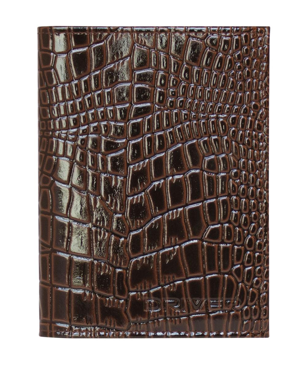 Обложка для автодокументов Driver, цвет: коричневый. АО4СРАО4СРОбложка для автодокументов Driver выполнена из высококачественной натуральной глянцевой кожи коричневого цвета и оформлена декоративным теснением под крокодила. На внутреннем развороте - съемный блок из шести прозрачных файлов из мягкого пластика, один из которых формата А5. Также обложка имеет два маленьких отделения для хранения sim-карт. Обложка не только поможет сохранить внешний вид ваших документов и защитит их от повреждений, но и станет стильным аксессуаром, который подчеркнет ваш неповторимый стиль. Кожгалантерея Driver изготовлена из высококачественной натуральной кожи. Специальное защитное покрытие способствует долгой службе изделий. Вся продукция гипоаллергенна. Прозрачные растительные краски подчеркивают натуральную фактуру. Множество отделений позволит сохранить документы в порядке. Характеристики: Материал: натуральная кожа, ПВХ. Размер обложки: 9,5 см х 12,5 см. Размер упаковки: 9,5 см х 1,5 см х 17,5 см. Цвет: коричневый. ...