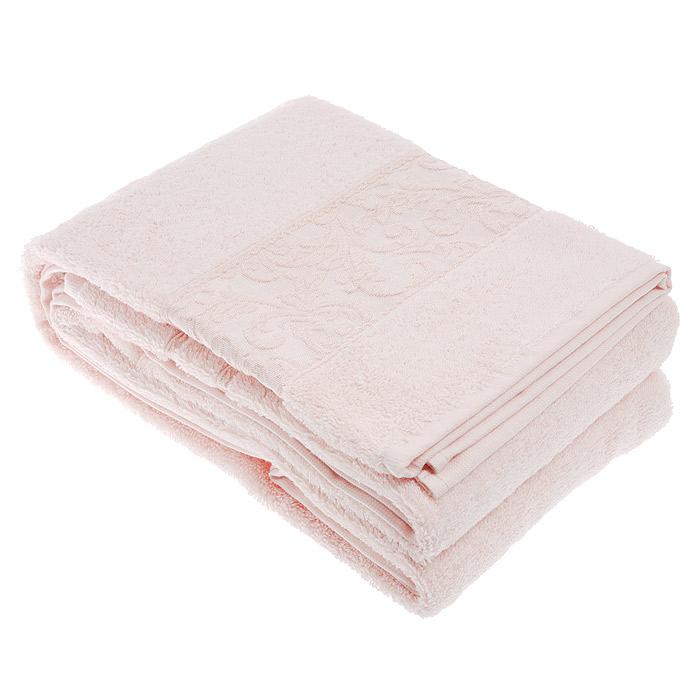 Полотенце махровое Ravenna, цвет: Pink (розовый), 70 см х 140 смRavenna PinkМахровое полотенце Ravenna, изготовленное из хлопка и бамбука, подарит массу положительных эмоций и приятных ощущений. Полотенца из бамбука только издали похожи на обычные. На самом деле, при первом же прикосновении вы ощутите невероятную мягкость и шелковистость. Таким полотенцем не нужно вытираться - только коснитесь кожи - и ткань сама все впитает! Несмотря на богатую плотность и высокую петлю полотенца, оно быстро сохнет, остается легким даже при намокании. Полотенце оформлено красивым жаккардовым бордюром, выполненным с орнаментом в цвет полотенца. Благородный тон создает уют и подчеркивает лучшие качества махровой ткани. Махровое полотенце Ravenna станет достойным выбором для вас и приятным подарком для ваших близких. Полотенце упаковано в подарочную коробку с прозрачным окошком. Характеристики: Материал: 60% бамбук, 40% хлопок. Размер: 70 см х 140 см. Плотность: 520 г/м2. Цвет: Pink (розовый). Размер упаковки: 29,5 см х...