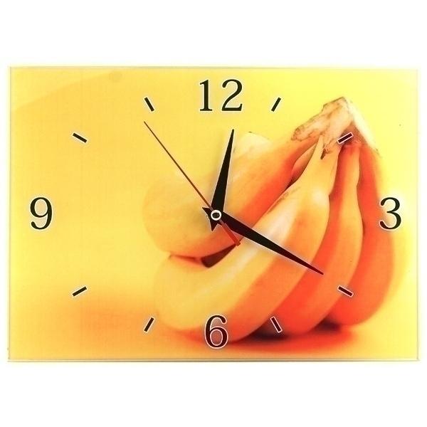 Часы настенные Бананы, стеклянные, цвет: желтый. 9530795307Оригинальные настенные часы Бананы прямоугольной формы выполнены из стекла и оформлены изображением бананов. Часы имеют три стрелки - часовую, минутную и секундную. Циферблат часов не защищен. Необычное дизайнерское решение и качество исполнения придутся по вкусу каждому. Оформите совой дом таким интерьерным аксессуаром или преподнесите его в качестве презента друзьям, и они оценят ваш оригинальный вкус и неординарность подарка. Характеристики: Материал: пластик, стекло. Размер: 28 см x 20 см x 2 см. Размер упаковки: 30 см х 21,5 см х 4,5 см. Артикул: 95307. Работают от батарейки типа АА (в комплект не входит).