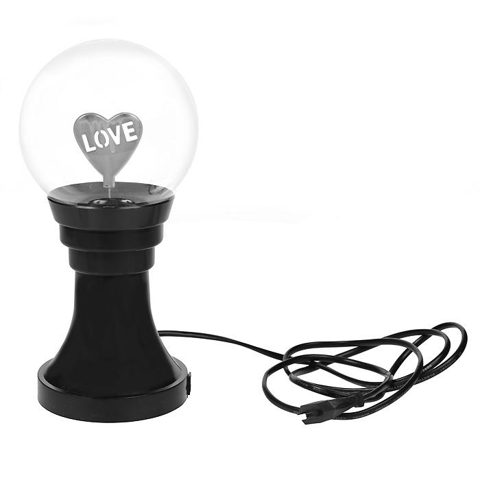 Светильник-плазма Любовь. 4064040640Светильник-плазма Любовь представляет собой стеклянный шар на подставке. Внутри шара расположена фигурка в виде сердечка с надписью Love. При включении внутри стеклянной сферы создается множество цветных молний. Молнии разбегаются во все стороны из центра, а если прикоснуться к поверхности шара пальцем, они сольются в один мощный поток. Светильник работает от электросети. На подставке имеется выключатель, благодаря чему вам не придется постоянно выдергивать шнур из розетки. Светильник-плазма Любовь будет прекрасным дополнением к вашему интерьеру, а так же может послужить замечательным подарком.