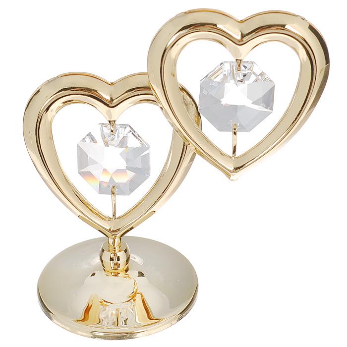 Фигурка декоративная Два сердца, цвет: серебристый, золотистый. 6708267082Притягательный блеск и невероятная утонченность декоративной фигурки Два сердца великолепно дополнят интерьер и, несомненно, не останутся без внимания. Фигурка выполнена из металла с блестящим золотистым покрытием в виде двух сердечек на шаровидной подставке и украшена двумя крупными кристаллами Swarovski. Декоративная фигурка Два сердца послужит прекрасным подарком ценителю изысканных и элегантных вещиц. Характеристики: Материал: металл, кристаллы Swarovski. Размер фигурки: 6 см х 0,5 см х 7 см. Цвет: серебристый, золотистый. Артикул: 67082.