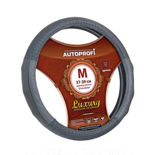 Оплетка руля Autoprofi Luxury AP-1040, с тиснением под крокодила, цвет: серый. Размер M (38 см). AP-1040 GY (M)AP-1040 GY (M)Оплетка руля Autoprofi Luxury выполнена из натуральной автомобильной кожи - материала, который обладает высокой износостойкостью, не выцветает на солнце и не требует трудоемкого ухода. Основная особенность данной модели - тиснение материала изделия под крокодиловую кожу. Это не только добавляет респектабельные и оригинальные черты салону автомобиля, но и повышает удобство работы с рулевым колесом. В местах хвата оплетка дополнена перфорированной кожей с выступами, благодаря чему руль лучше лежит в руках и не проскальзывает во время маневров.