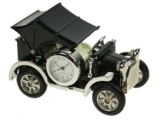 Часы настольные Ретро автомобиль, цвет: черный, серебристый. 2242022420Оригинальный дизайн настольных часов Ретро автомобиль разработан с учетом современных тенденций оформления интерьеров. Выполненные из металлического сплава в виде старинного авто, эти часы, несомненно, будут привлекать к себе внимание. Колеса и крыша машины подвижны. Часы с кварцевым механизмом работают плавно и бесшумно и требуют лишь примерно раз в год замены батарейки. На циферблате имеются часовая, минутная и секундная стрелки. Такие часы легко впишутся в любой интерьер и станут великолепным подарком!